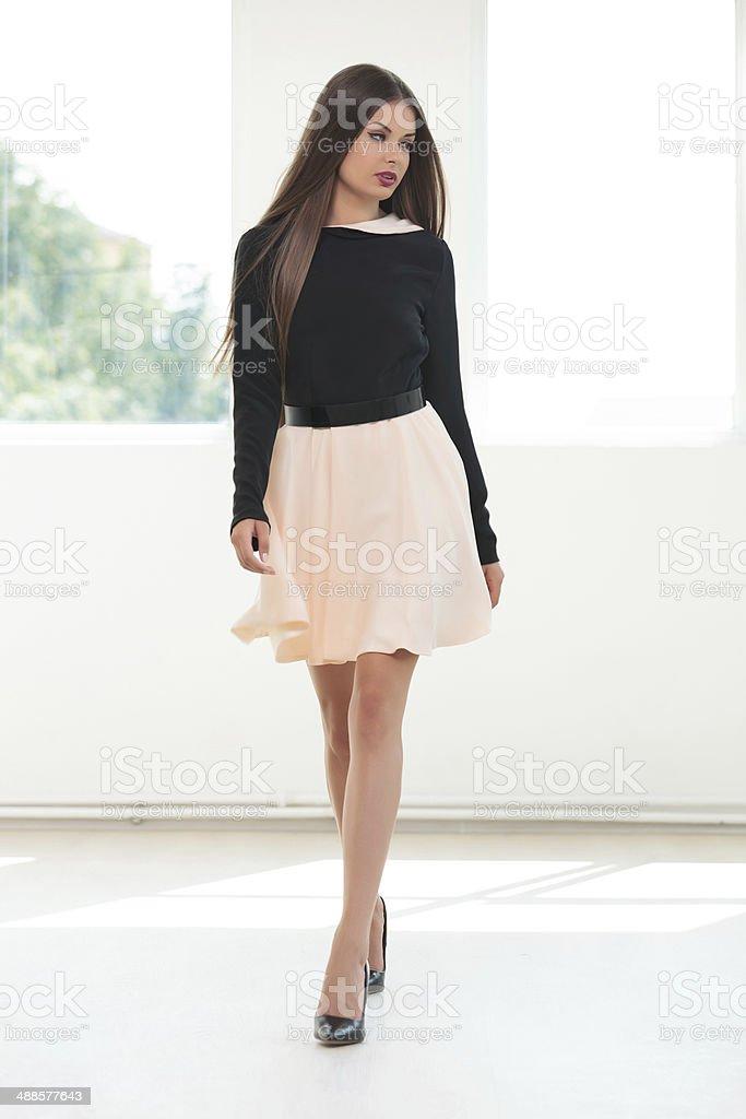young fashion woman walks to you stock photo