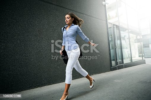 Business woman with laptop bag