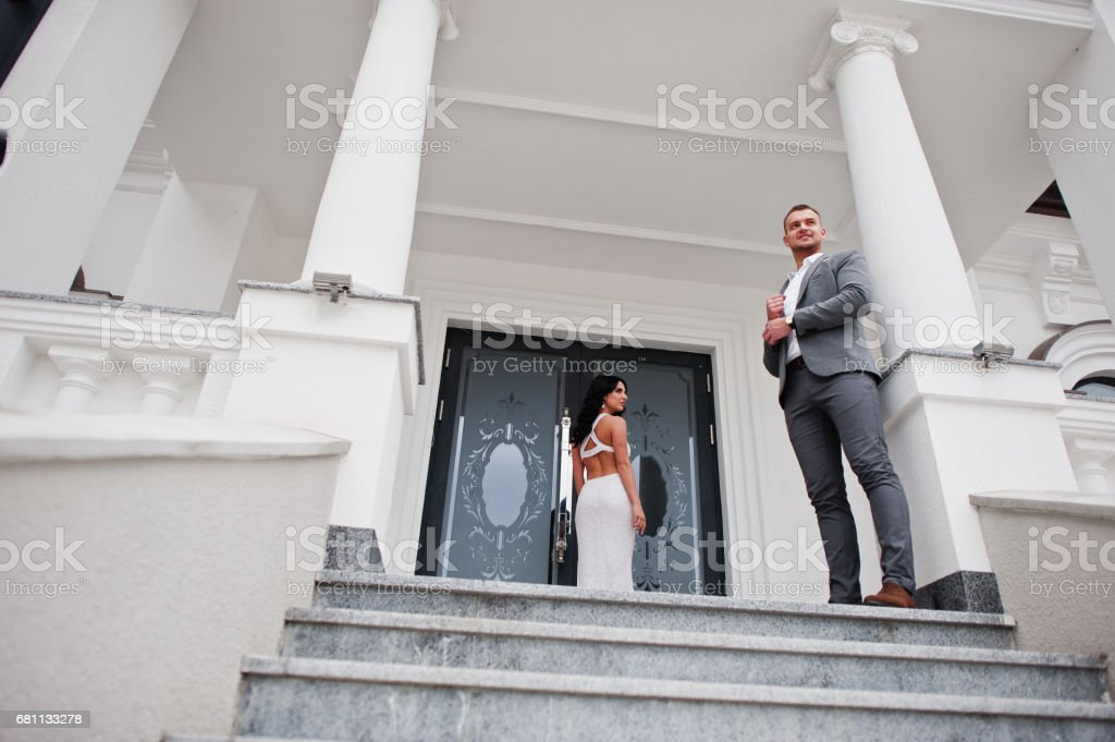 Young fashionable lovely couple at wedding anniversary and marriage proposal day against royal palace. royalty-free stock photo