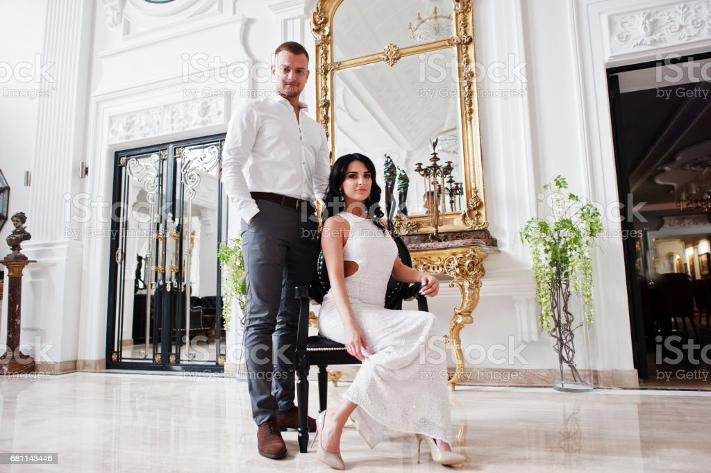 Young fashionable lovely couple at wedding anniversary and marriage proposal day indoor royal palace. royalty-free stock photo
