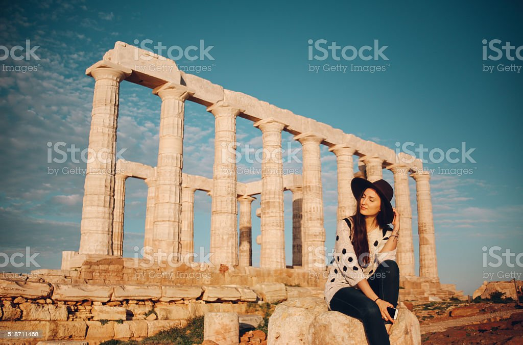 Young fashionable tourist woman relaxing and sightseeing in Greece stock photo