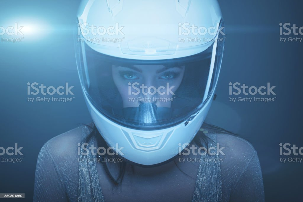 Young fashionable woman in helmet portrait stock photo