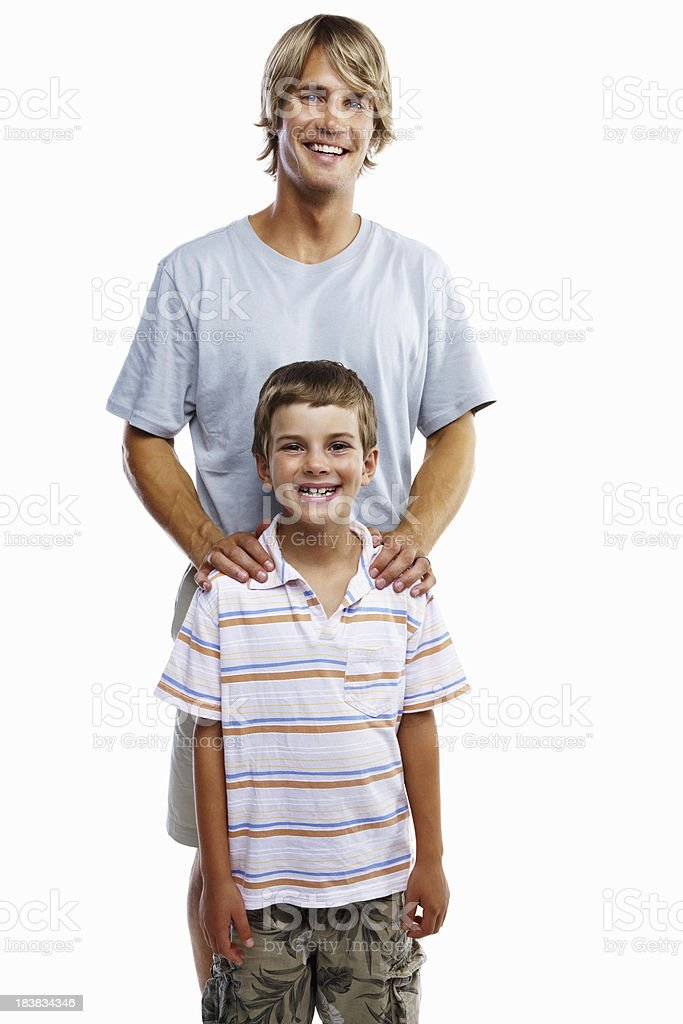 Young father and cute little son standing on white background royalty-free stock photo