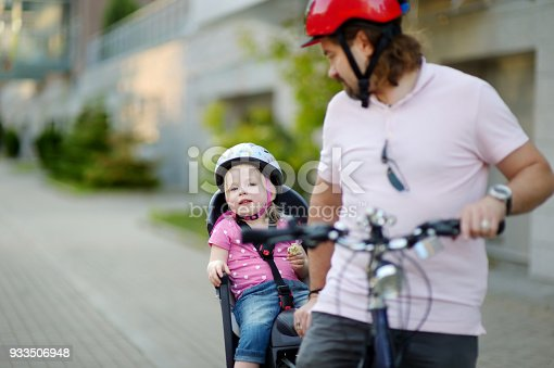 istock Young father and his toddler girl riding a bicycle 933506948