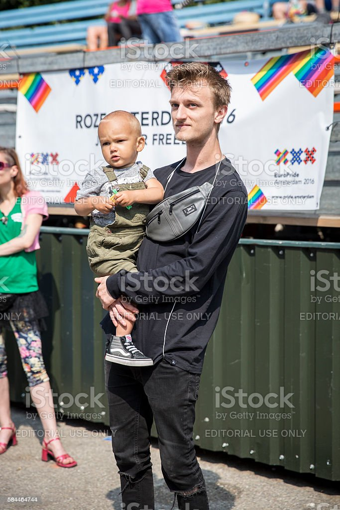 young father holding his son in his arms, Gay EuroPride stock photo