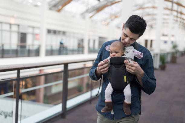 Young father shopping with baby stock photo