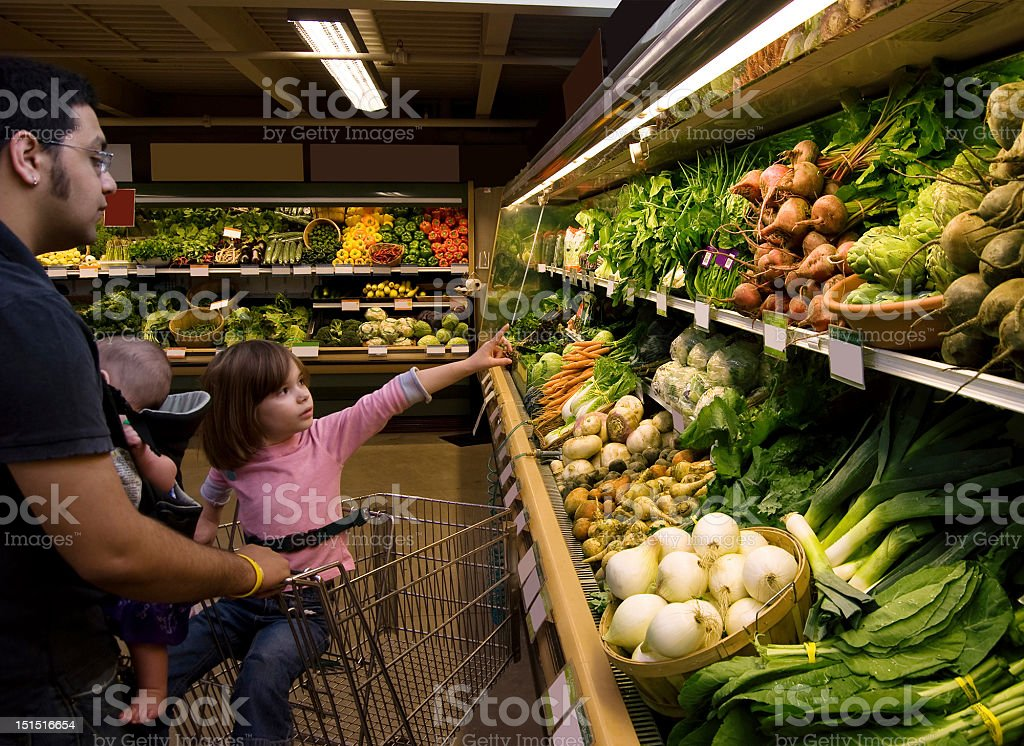 Young father shopping with two kids royalty-free stock photo