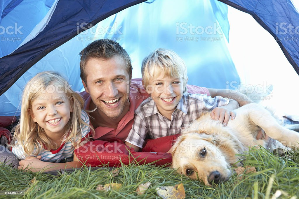 Young father with children in tent royalty-free stock photo
