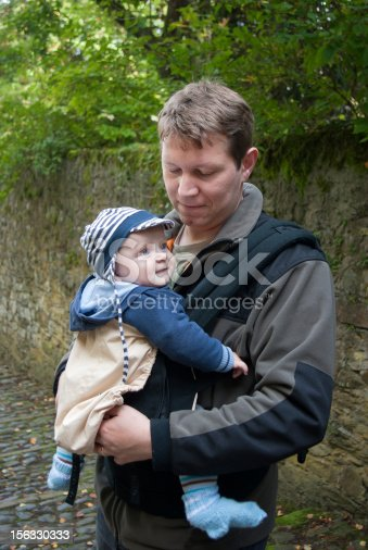 istock Young father with little toddler boy in rucksack 156330333