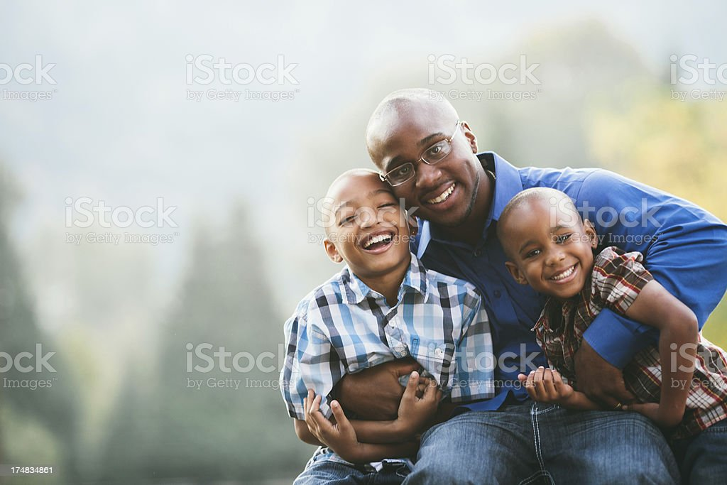 Young father with two sons stock photo