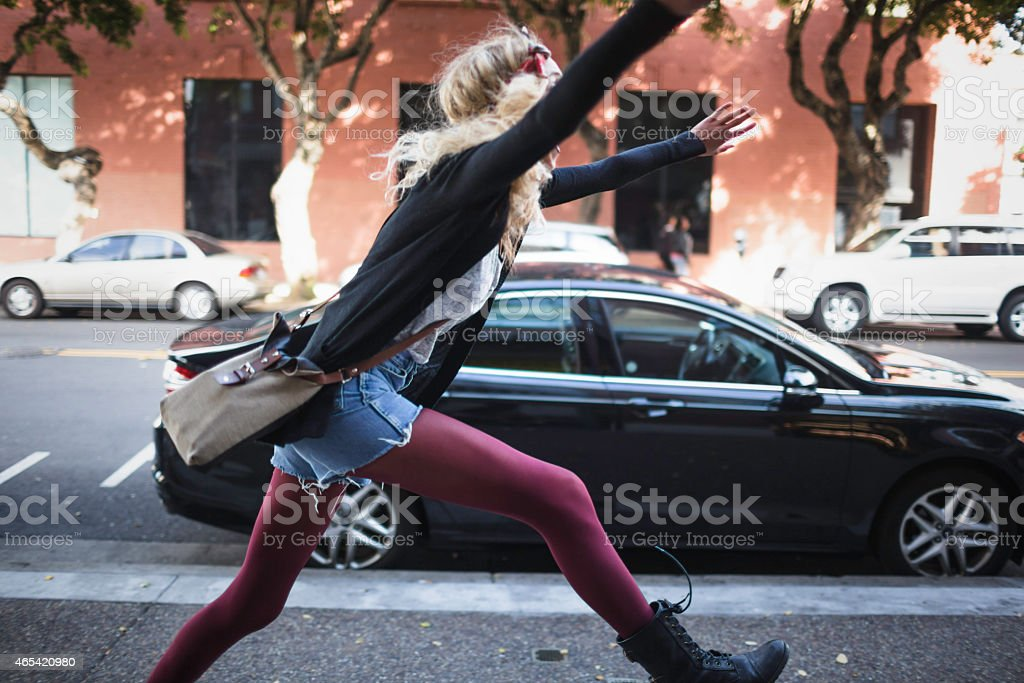 Young Female Adult Running Ready to Shop stock photo