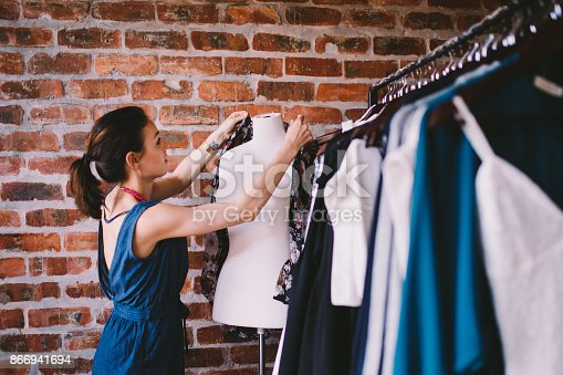 Young female adult working in fashion boutique