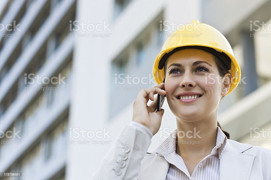 Young female architect talking on mobile phone royalty-free stock photo