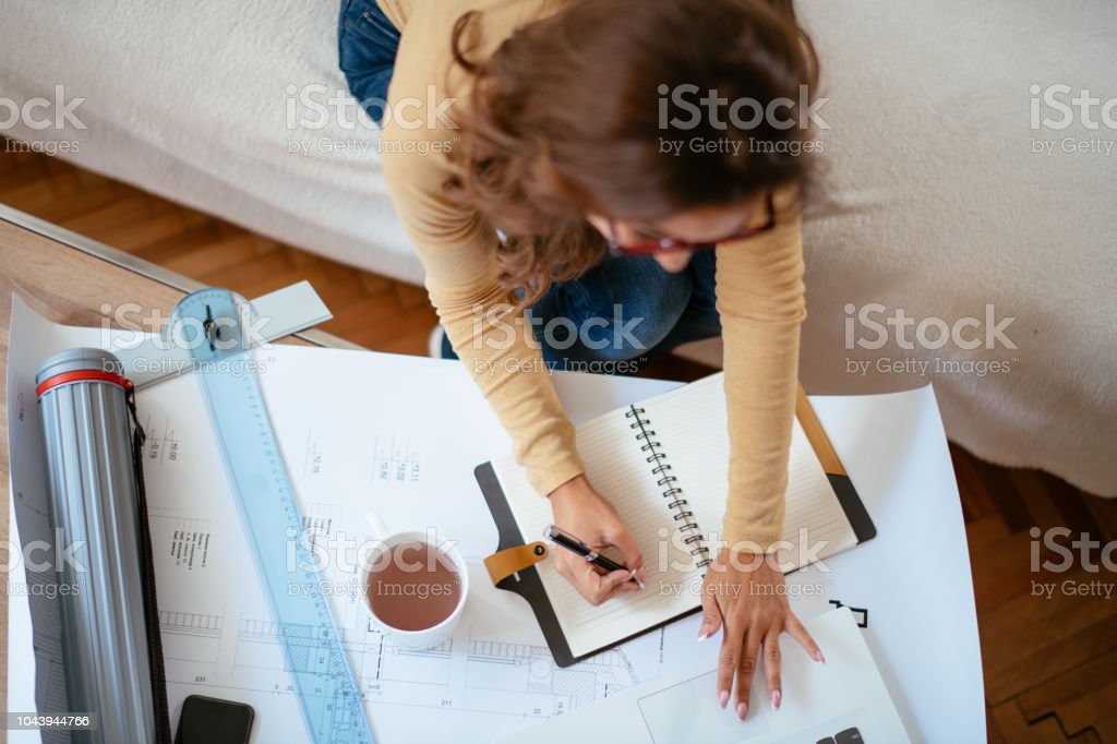 Young female architect working from home. Developed from RAW;...