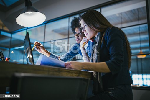 istock Young female architects working together in architecture studio 918035570