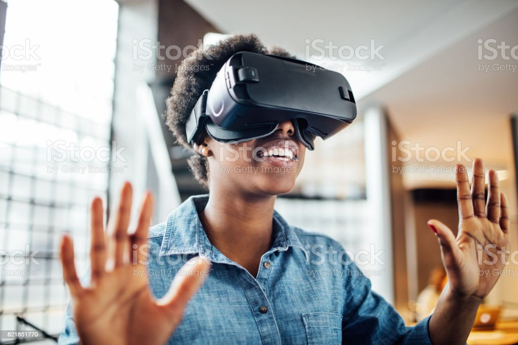 Young female at startup using VR goggles stock photo