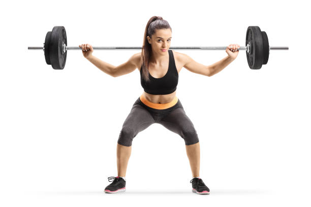 Young female athlete lifting weigths stock photo