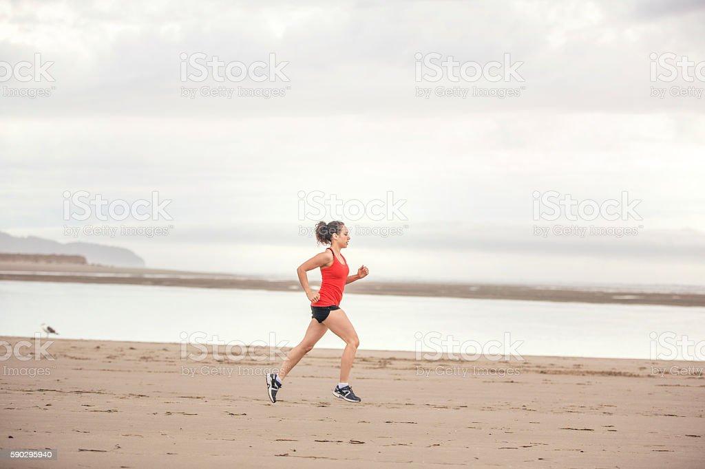 Young female athlete profile while running royaltyfri bildbanksbilder