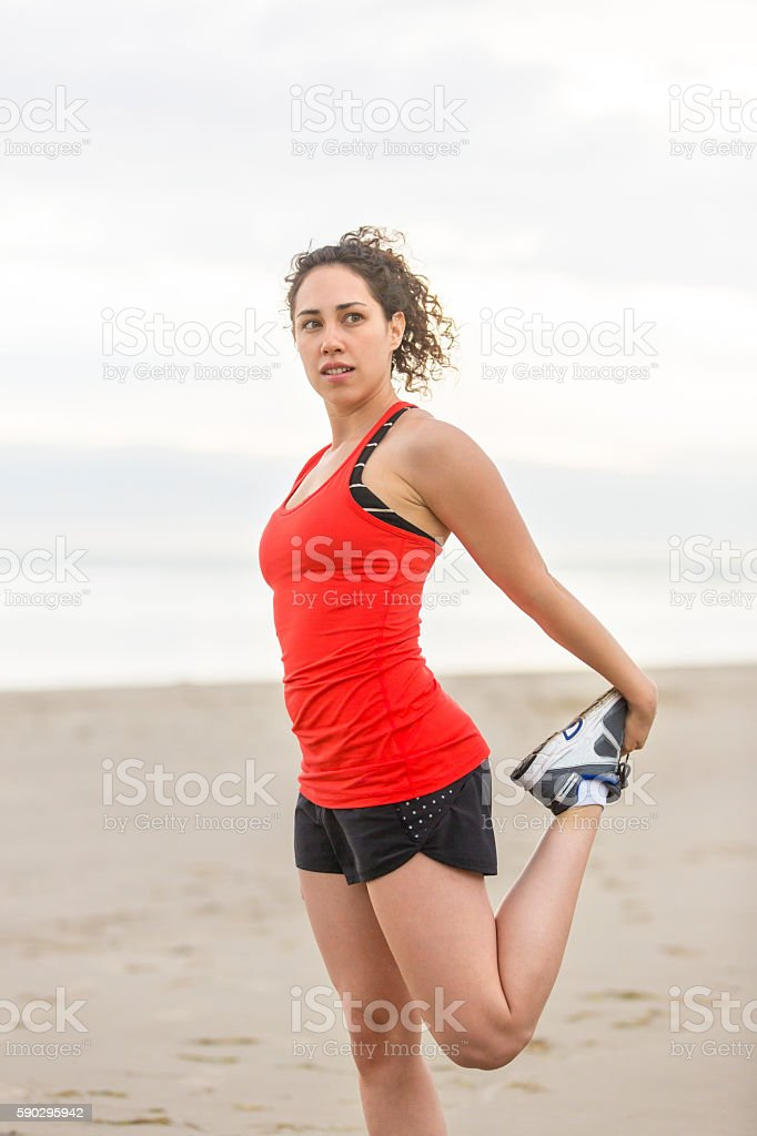 Young female athlete stretching after her workout royaltyfri bildbanksbilder