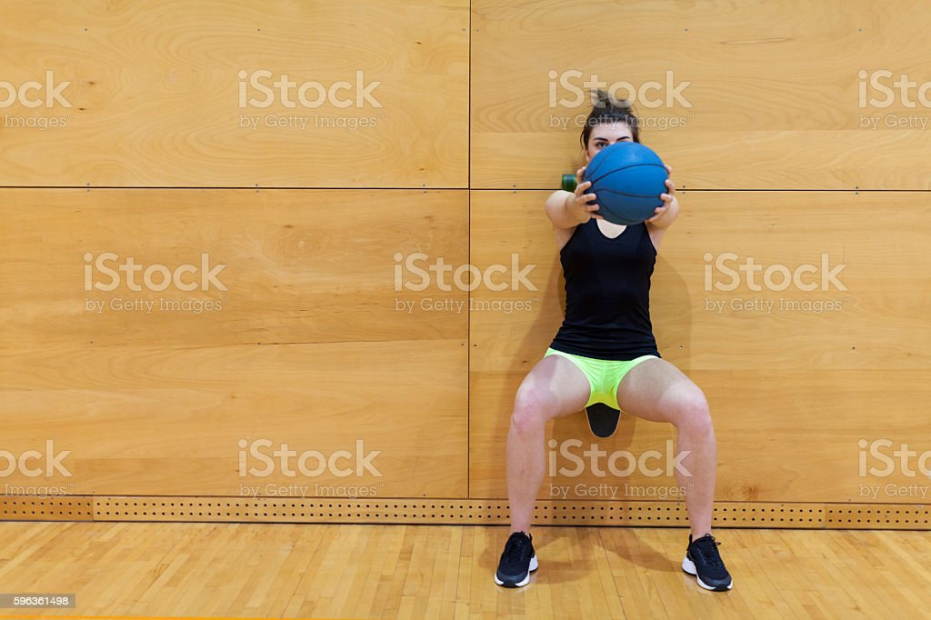 Young Female Athlete Stretching Workout in a Gym Front View royalty-free stock photo