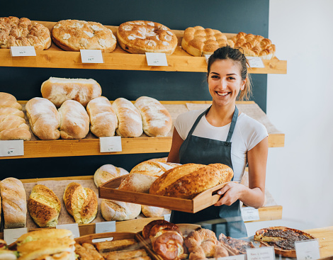 istock Young female baker 639897672