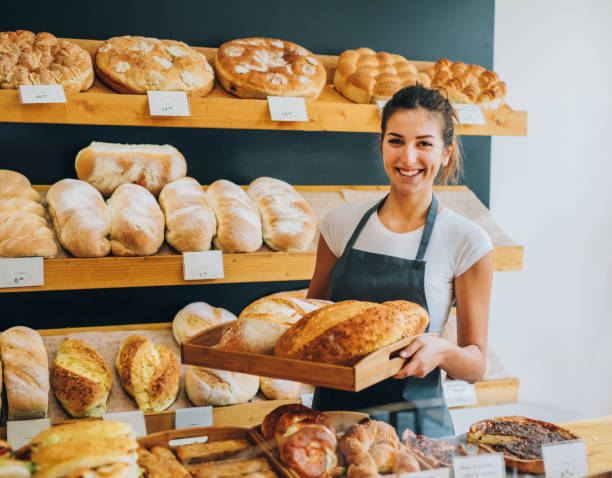 young female baker - bakery stockfoto's en -beelden
