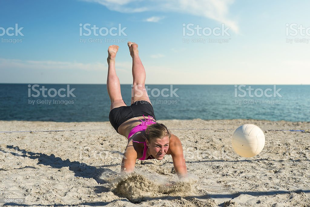 Young Female Beach Volley Player in the Attractive Action stock photo