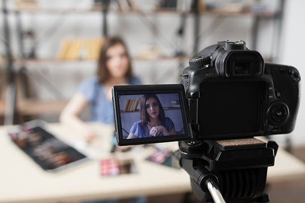 Young female beauty blogger on camera screen stock photo