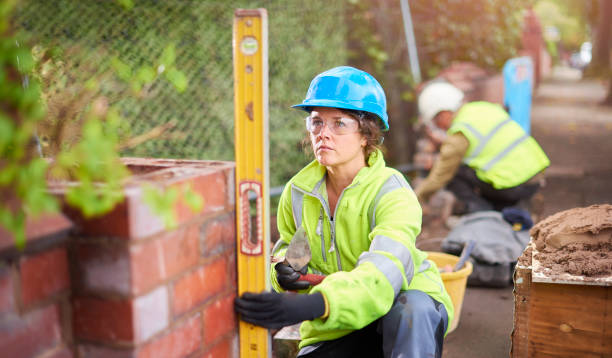 young female bricklayer stock photo