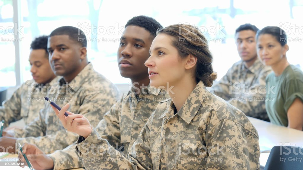Young Female Cadet Asks Question In Military Training Class Stock