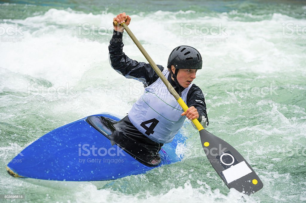 Young Female Canoeist on Wild Water During the Race stock photo