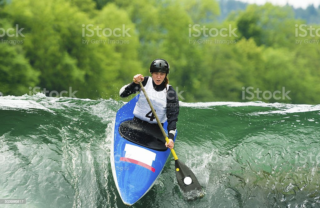 Young Female Canoeist Starting the Race stock photo