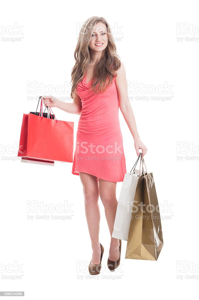 Young female carrying shopping bags royalty-free stock photo