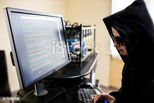 istock Young female computer programmer as hacker 917468296