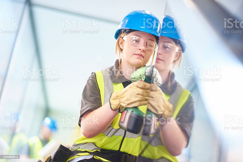 young female construction worker stock photo