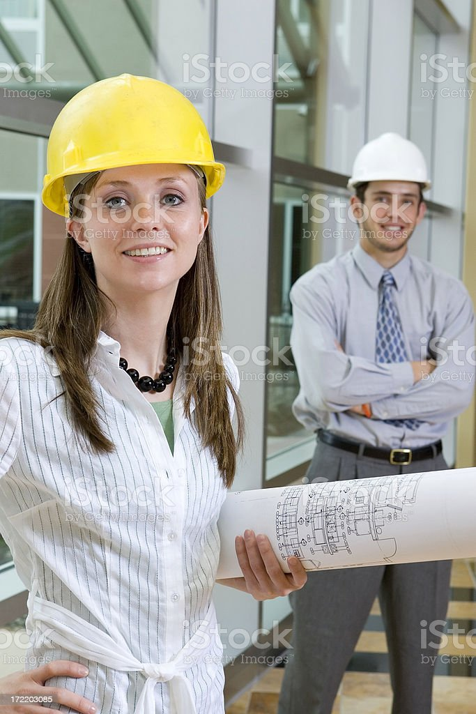 Young Female Contractor with Blueprints royalty-free stock photo