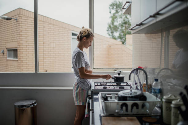 young female cooking - day in the life series stock pictures, royalty-free photos & images