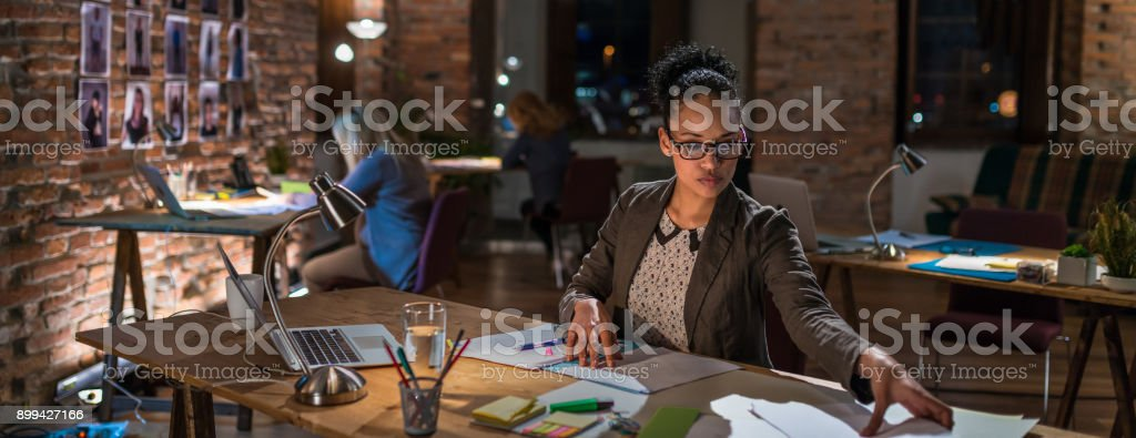 Young Female Creative Professional Working Late
