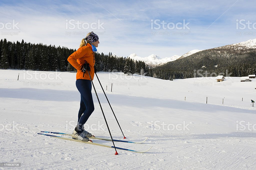 Young female cross country skier posing on the slope royalty-free stock photo