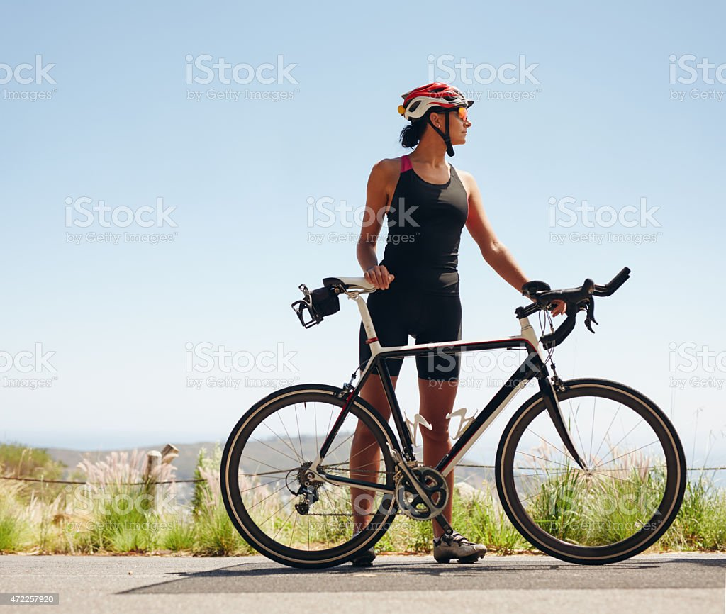 Young female cyclist looking away stock photo