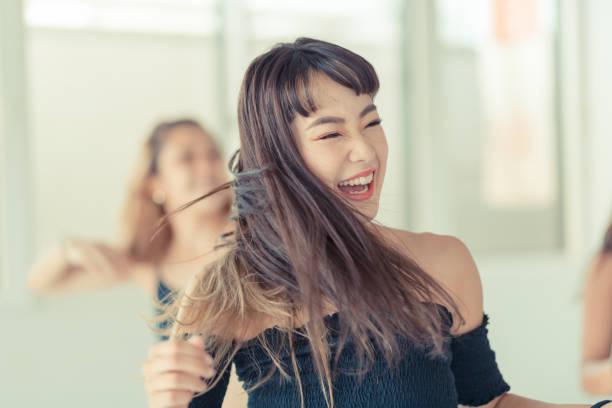 young female dancers dance in studio - asia orientale foto e immagini stock