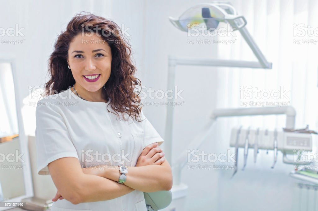 Young female dentist in office stock photo