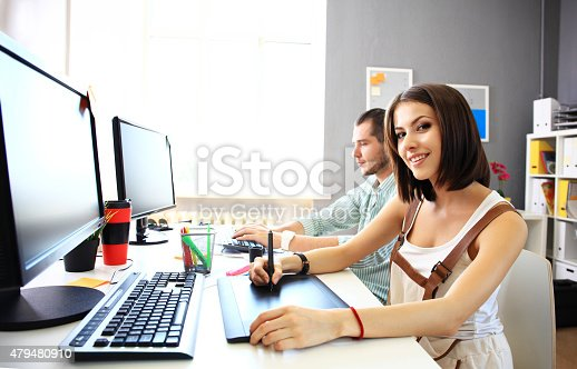 istock Young female designer using graphics tablet while working 479480910