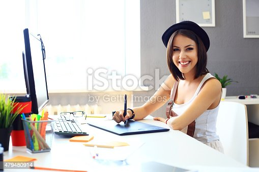 istock Young female designer using graphics tablet while working 479480914