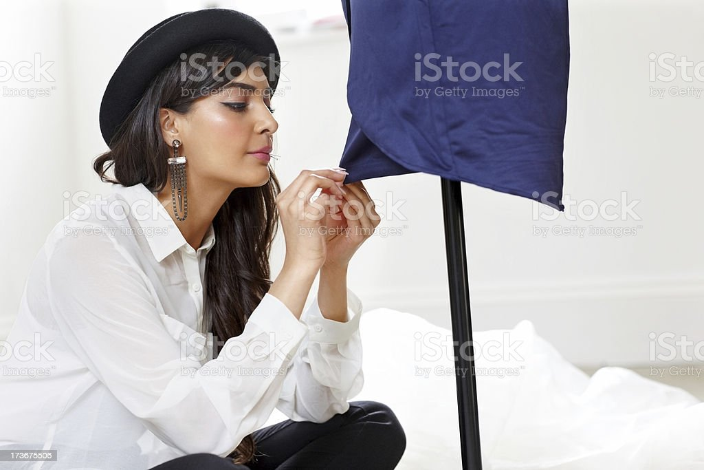 Young female designer working in fashion studio royalty-free stock photo