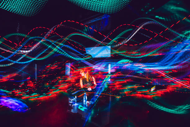 Young Female DJ Performing, Light Painting Young Female DJ Performing, Light Painting electronic music stock pictures, royalty-free photos & images