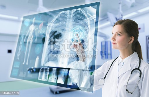istock Young female doctor and futuristic medical interface concept. 904427718