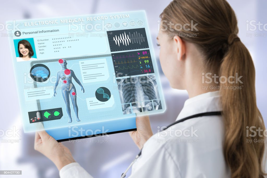 Young female doctor and futuristic medical interface concept. stock photo