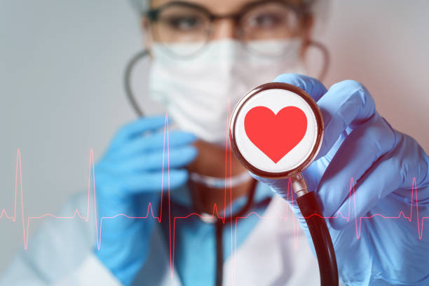Young female doctor cardiologist with a stethoscope stock photo
