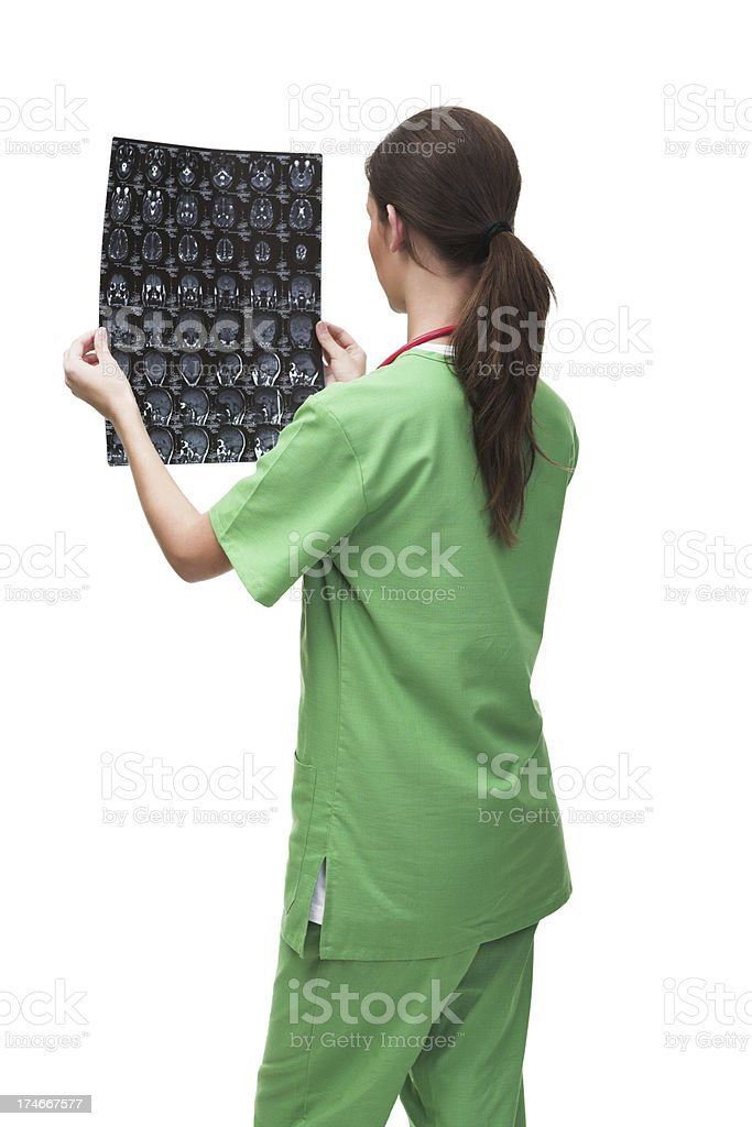 Young female doctor checking an MR exposure royalty-free stock photo
